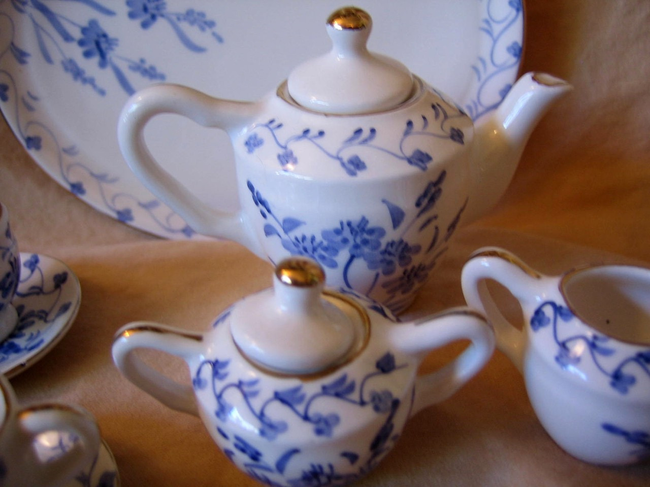 Doll Tea Set - Elegant Miniature Blue White Gold Leaf Teapot Cups Sugar Creamer Tray Edge www.DecorativeDishes.net